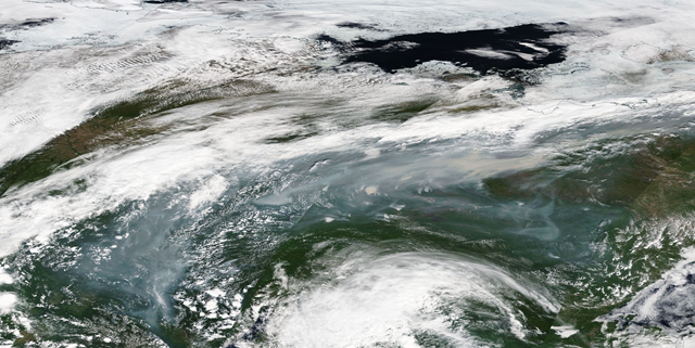 This satellite image shows wildfire smoke over central Siberia on 3 July 2018. Photo: NASA / MODIS