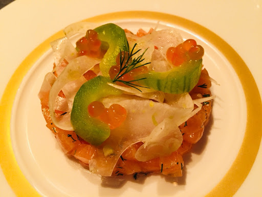 Salmon tartare garnished with salmon roe, cucumber , horseradish and fennel