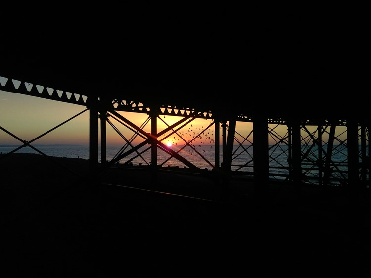 sunrise beneath the pier