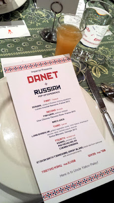 At DaNet, Once you find your seat, you should see two menus before you. The larger dinner menu one has an overview of the four family style courses you will be enjoying. The smaller menu is the specific list of the Zakuski