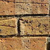 Natural look brick chimney sealer makes water bead up on the surface.  The mortar joints are also protected from water penetration.