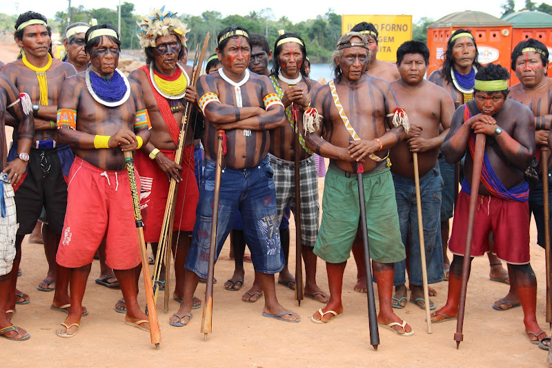 June 28, 2012 --- Day 8 of the indigenous occupation of the Belo Monte Dam Site along Brazil's Xingu River.  Tensions rise when the Federal Police arrives to notify the Xikrin, Arara, and Juruna peoples that the meeting with the President of Norte Energia (dam building consortium) will not take place at the site of the occupation but rather at the headquarters of Norte Energia.  More than 100 men, women and children eventually agreed to travel to Altamira.  The 3-hour meeting did not result in any agreements. Another meeting was scheduled for July 9th.  More than 300 people continue the occupation, stopping all construction on the main cofferdam on the Xingu river demanding that the project be suspended until the company fulfill its legal obligations to mitigate the serious impacts on 12 indigenous villages among these: inability to use the river for transportation, loss of fish, destruction of forest, loss of water quality, among other impacts. (Photo: Rafael Salazar)