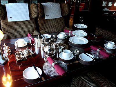 Table set for afternoon tea on the Spirit of Chartwell, the Diamond Jubilee barge for the Queen in London England