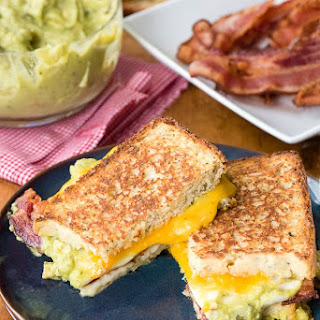 Grilled Triple Cheese Bacon Guacamole Sandwich.