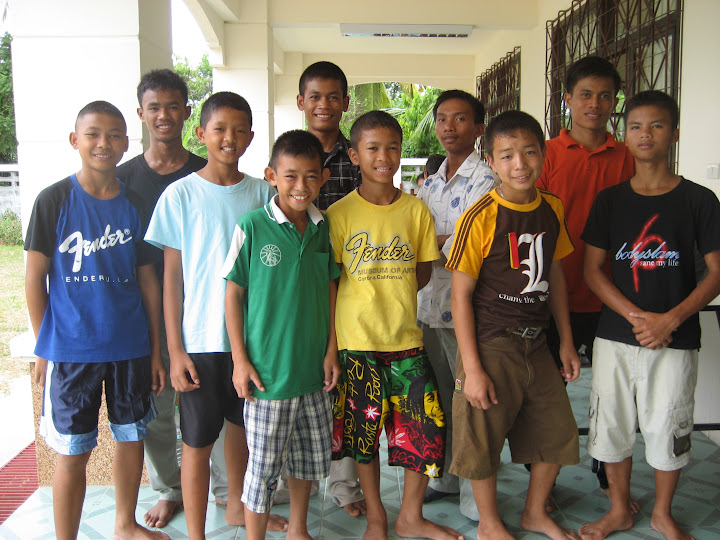 Group portrait of the boys in the care of GMFT outside of children's home