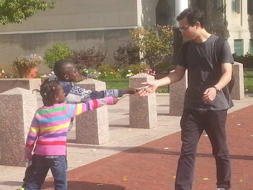 """Thank God for little Evangelists! Levi and Lydia did a SUPERB job handing out gospel tracts at Boston University. They were so bold and """"into it."""" I'm certain they put a smile on Jesus' face!"""