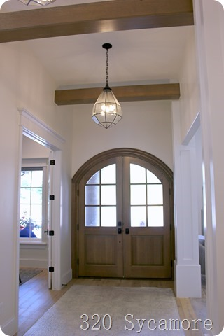 wood door entrway with beams