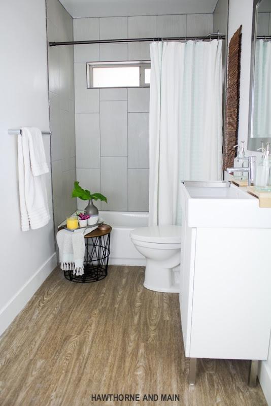 the-suite-pecan-bathroom-update-wtih-moen-bath-fixtues_-2-683x1024