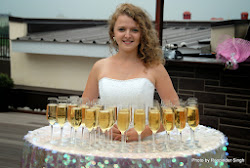 A girl serving Champagne to wedding guests