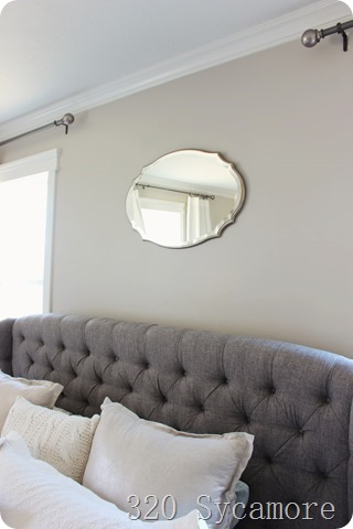 above the bed mirror