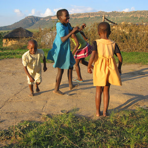 Children in Lesotho play 'Dropscotch' with a shoe polish tin