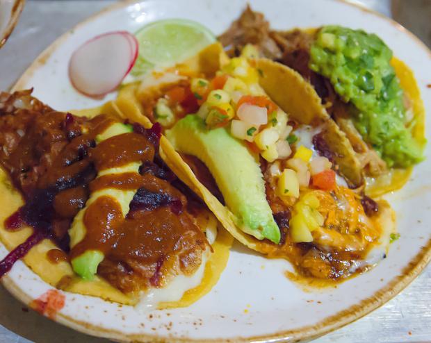 photo of Chicken Al Pastor, Potato Soy Chorizo, and Carnitas tacos