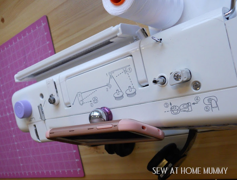 how to mount your cell phone to your sewing machine - quick cheap and easy idea! Love this for my studio space