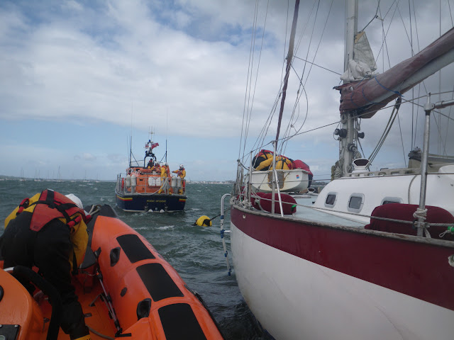 22 May 2011 – ILB and ALB alongside grounded yacht in Poole Harbour
