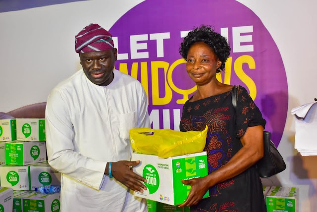 Ondo reps member, wife donate food items, cloths to widows