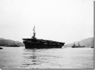 USS Cape Gloucester (CVE-109) anchored in mid-stream at Nagasaki, waiting to take aboard liberated Allied prisoners of war. Photographed by Private First Class L.F. DeRycke, 5 September 1945. Official U.S. Marine Corps Photograph, now in the collections of the National Archives and Records Administration (NARA), # 127-GW-1643-138641.