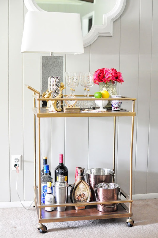 This Target bar cart looks chic with metallic and bright accessories. It fits perfectly with any decor style.