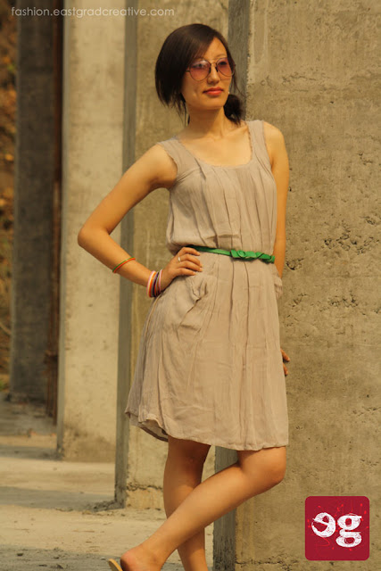 Aviator, cool summer dress paired with matching belt for a sunny day