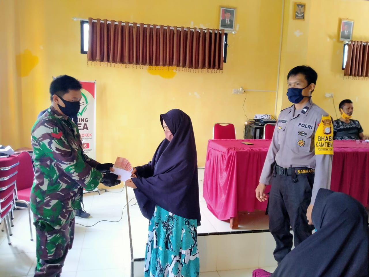Babinsa Koramil 1423-04 /Citta Melaksanakan Pendampingan  Penyaluran BLT-DD Tahap 2