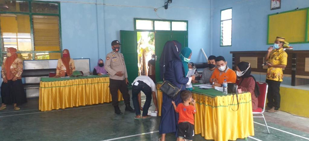 Polsek Ganra Bersama Danposramil Giat Pengamanan di Aula Desa Ganra