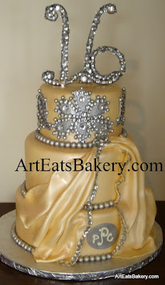 Champagne pearl fondant sweet sixteen girl's birthday cake with rhinestones, silver pearls, draping to match her dress, monogram and handmade 16 topper