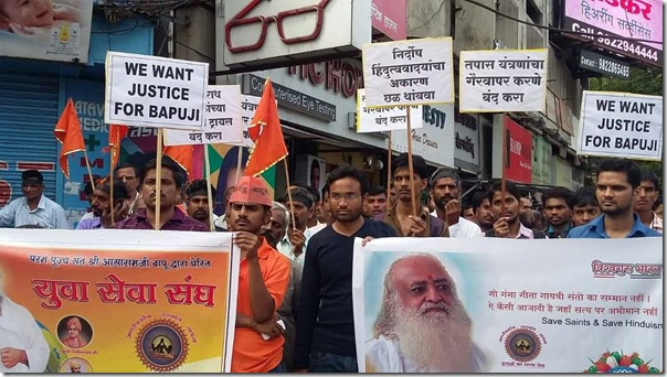 Residents of Pune wave flags and banners against Black Day