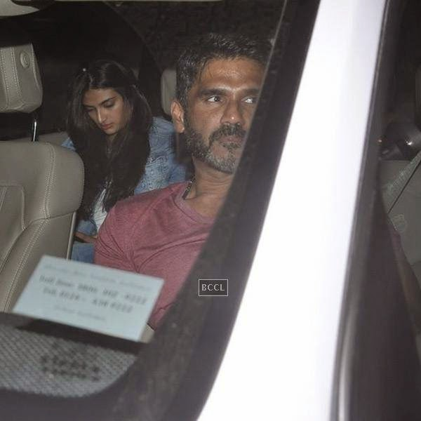 Suniel Shetty with his daughter Athiya at the screening of a movie, in Mumbai, on July 24, 2014. (Pic: Viral Bhayani)<br />