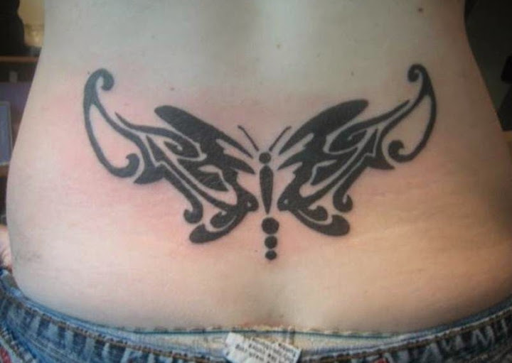 tribal butterfly tattoos designs on lower back of a girl