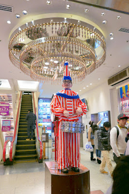 Sights of Osaka - Kuidaore Taro, the famous drumming clown.