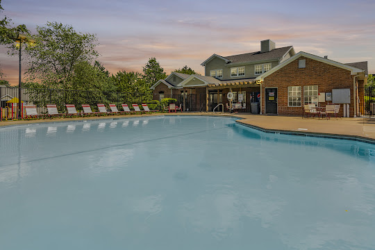 Fieldstone apartment swimming pool at dusk