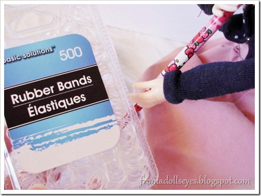 Doll bloopers with some tips for taking doll photos.  Clear hair elastics help when a doll needs to hold something.