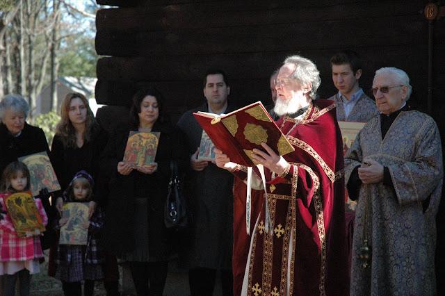 Fr. John proclaims the Gospel.