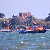 The ALB tows a yacht past Brownsea Island. 3 August 2014.  Photo credit: Dave Riley