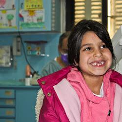 smiling girl missing teeth.jpg