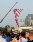 The big American flag over the starting line.