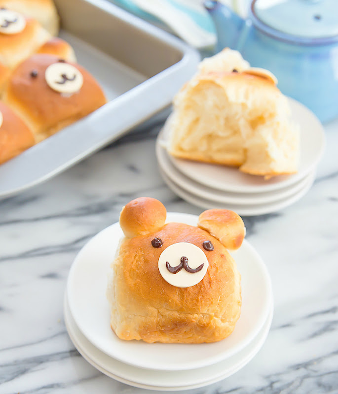 a close-up photo of a bear-shaped roll on a white plate