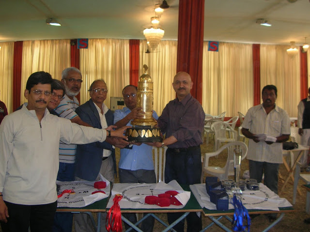 2008 Winter Nationals - The 2008 Team of Four Winners receiving the Ashok R. Ruia Trophy from Shri Y. Kamlakara Rao, President Bridge Federation of India