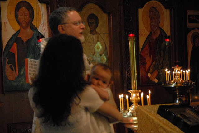 Fr. John congratulates the family and prays that God will grant them all many years.