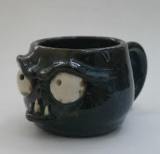 "Photo: Mug 12 * __ * 2.5"" tall. *  Holds ~ 0.75 cup"