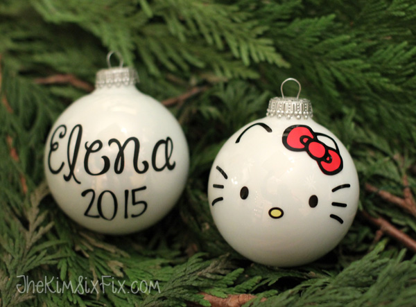 Hello kitty face ornament from christmas ball. Easy to use up vinyl scraps on this project