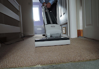 professional carpet cleaners cleaning a passage fitted with a carpet