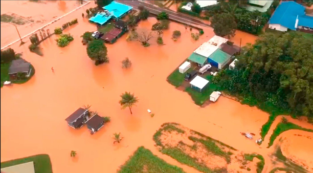 Aerial view of flooding in a neighborhodd on the island of Kauai in April 2018. Floodwaters on the Hawaiian island of Kauai turned orange, a sign of the high iron content in the volcanic soil. Photo: Brandon Verdura / Associated Press