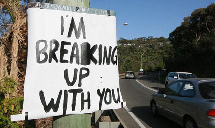 Man Dumps Girlfriend Using Signs Image