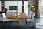 cucina La Casa Moderna, penisola  in legno con gambe in vetro.JPG