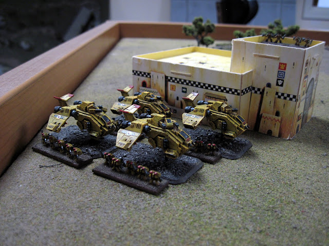 Assault Marines move up the flank in some sweet rides.