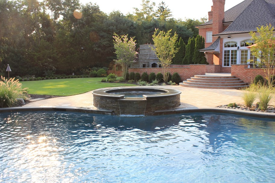 Pools And Spas Westbury  Free Form Custom Gunite Pool with Sheer Descent Waterfalls and Spill Over Gunite Spa - Old Westbury, Long Island NY