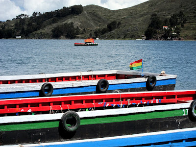Truck on a ferry across the river en route from Copacabana to La Paz in Bolivia