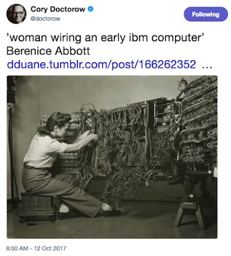 A common photo on Twitter shows a woman wiring an early IBM computer.