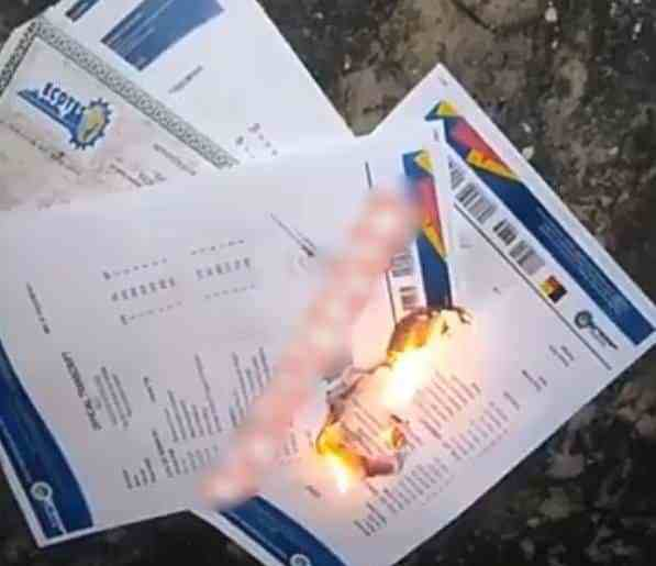 Nigerian Graduate Burns His Certificates, Says School Is The Biggest Scam Ever