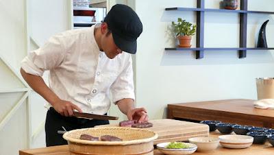 Ryan Roadhouse begins plating the grilled A5 Wagyu steak at SupaHardcore